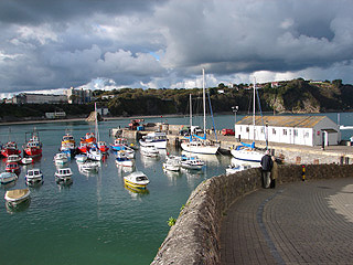 On the path to the pier in Tenby harbour, Croft Court in the distance